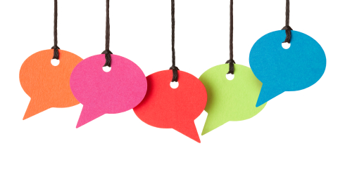 Five blank speech bubbles hanging from thread